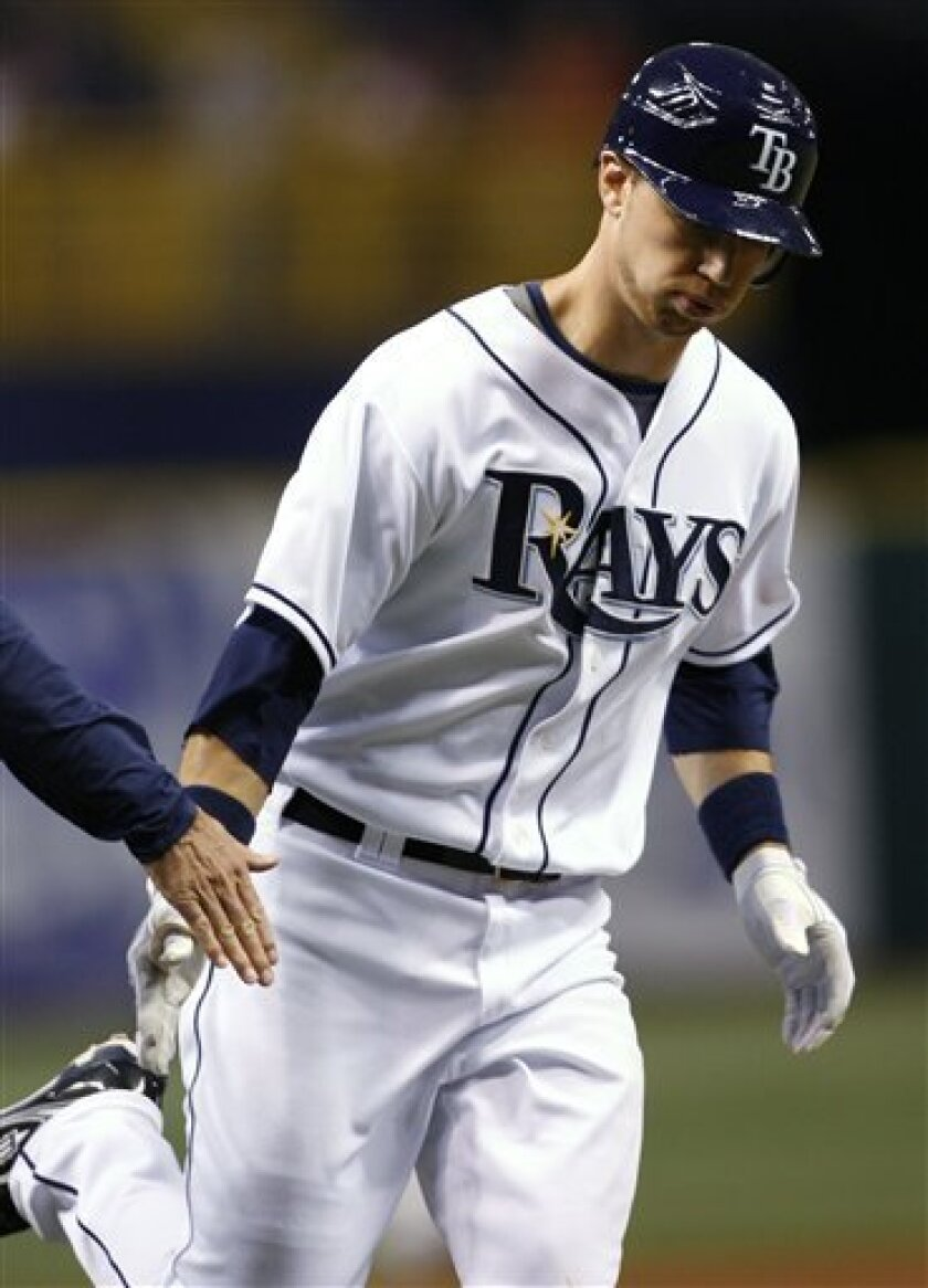 Tampa Bay Rays' Ben Zobrist slaps hands with first base coach Tom Foley as he rounds the bases on his three-run home run in the fourth inning of a baseball game against the Toronto Blue Jays on Wednesday, July 8, 2009, in St. Petersburg, Fla. (AP Photo/Brian Blanco)
