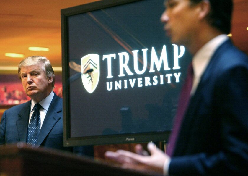 FILE- In this May 23, 2005, file photo, Donald Trump, left, listens as Michael Sexton introduces him at a news conference in New York where he announced the establishment of Trump University. The manual for Trump University events was precise: the room temperature should be 68 degrees. Seats should