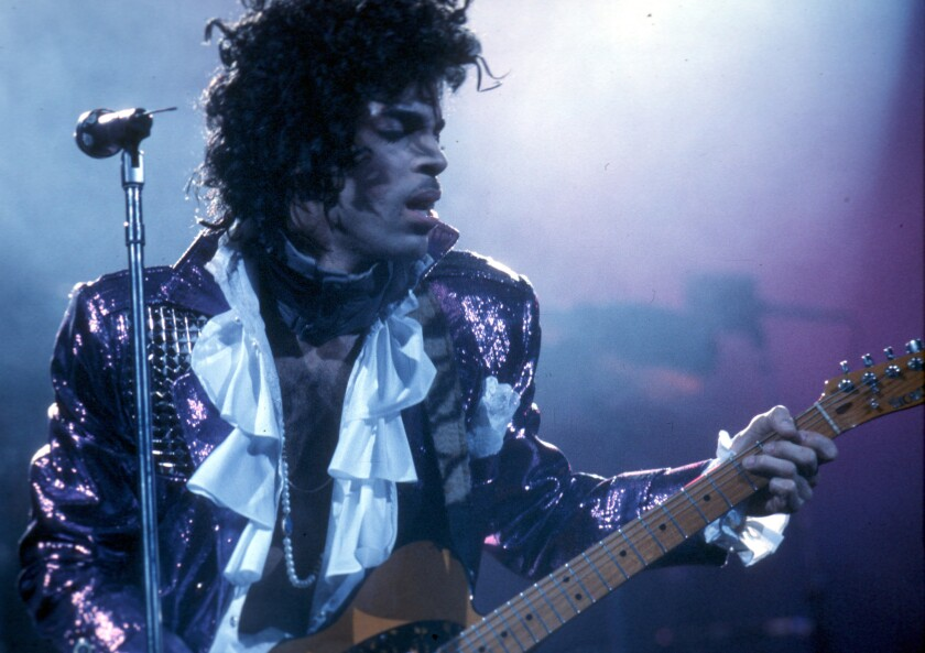 Wearing a ruffled shirt and shiny purple jacket, Prince performed at the Forum on February 19, 1985 in Inglewood.