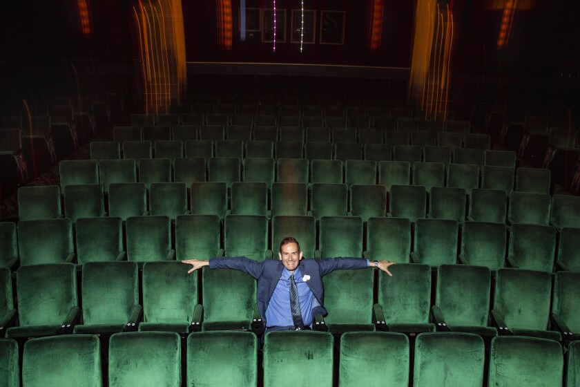 A man sits in an empty theater