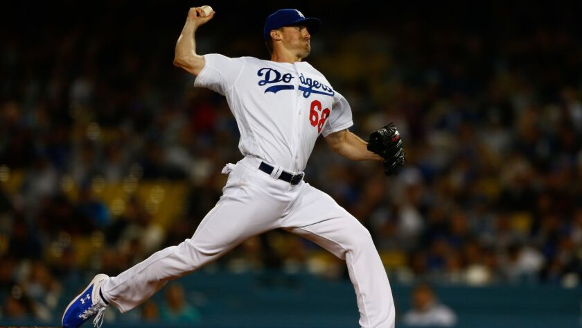 LOS ANGELES, CALIF. - APRIL 03: Los Angeles Dodgers starting pitcher Ross Stripling (68) pitches aga