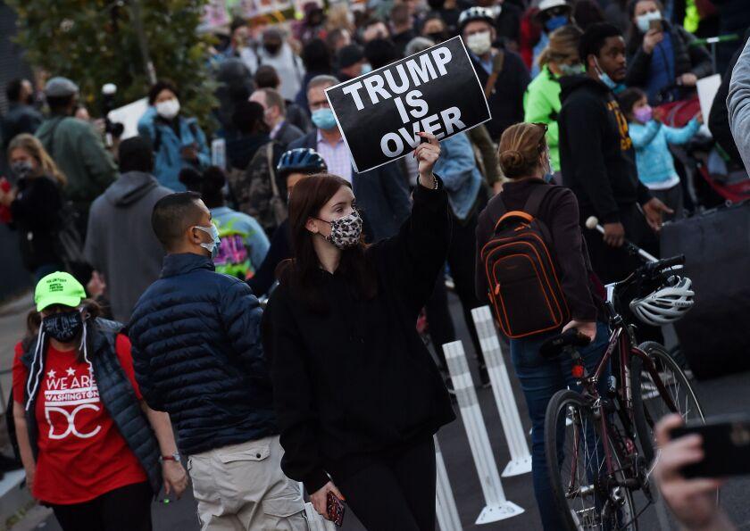 Demonstrators gather near the White House on Nov. 3.