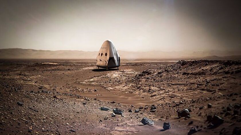 This artist rendering provided by SpaceX shows a Dragon capsule sitting on the surface of Mars. Spac