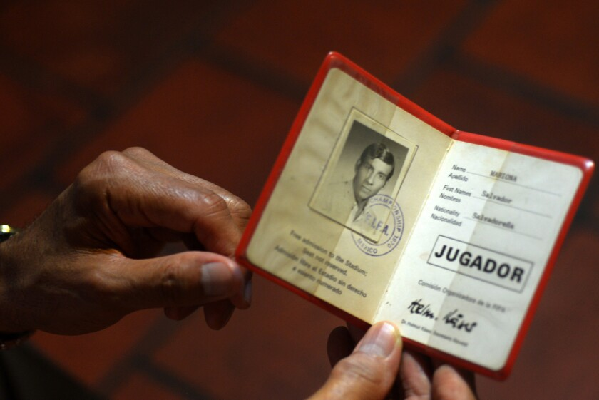 Salvador Mariona displays his participation card for the 1970 World Cup in Mexico.