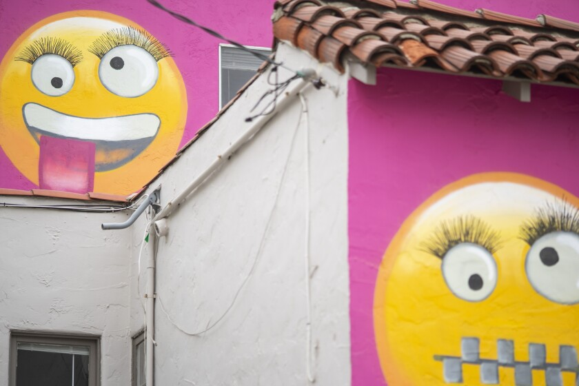 """A close-up at the emojis painted on the """"Emoji House"""" in Manhattan Beach."""