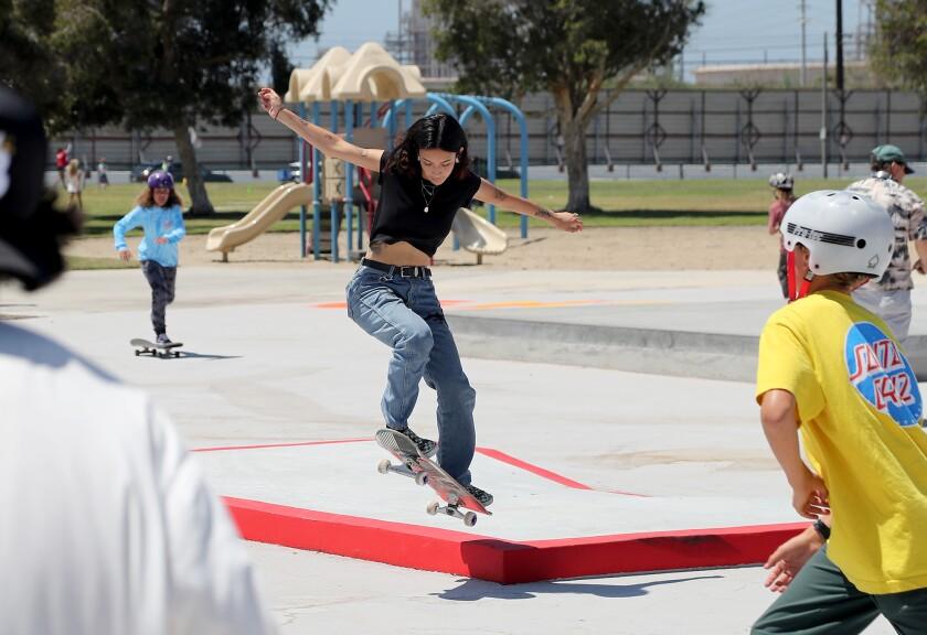 Alyssa Whitson, 21, ollies a curb at the new Edison Park Skate Spot on Thursday in Huntington Beach.