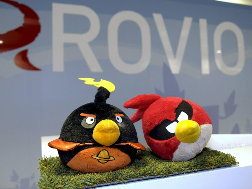 FILE _ A Sept. 20, 2012 photo from files of Angry Birds toy figures displayed at the Angry Birds company Rovio headquarters in Espoo, Finland. Angry Birds are getting angrier, because some of their real-life counterparts in the South Pacific are facing extinction. Rovio, the creator of the hugely popular Angry Birds games, says it's teaming up with nature conservationist group BirdLife to disseminate information and help collect funds to protect birds in the region that are particularly vulnerable to attacks by non-native predators introduced by humans. The Finnish company is launching the campaign as it releases the Angry Birds Fight game on May 7 in Asia Pacific, saying it hadn't realized until now that some of the most critically endangered bird species have populations lower than the number of staff at Rovio, which totals 700. (Sari Gustafsson/Lehtikuva via AP) FINLAND OUT