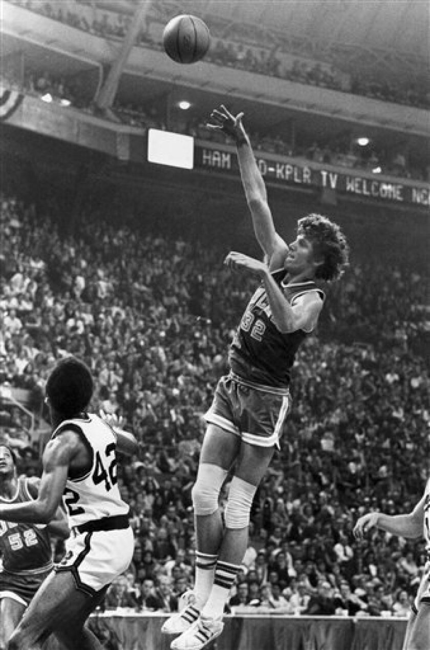 FILE - This March 26, 1973, file photo shows UCLA center Bill Walton shooting for two of his record 44 points against Memphis State in the final game of the NCAA basketball tournament in St. Louis, Mo. The 57-year-old Walton said that his former coach _ at the age of 99 _ was aware of UConn's strea