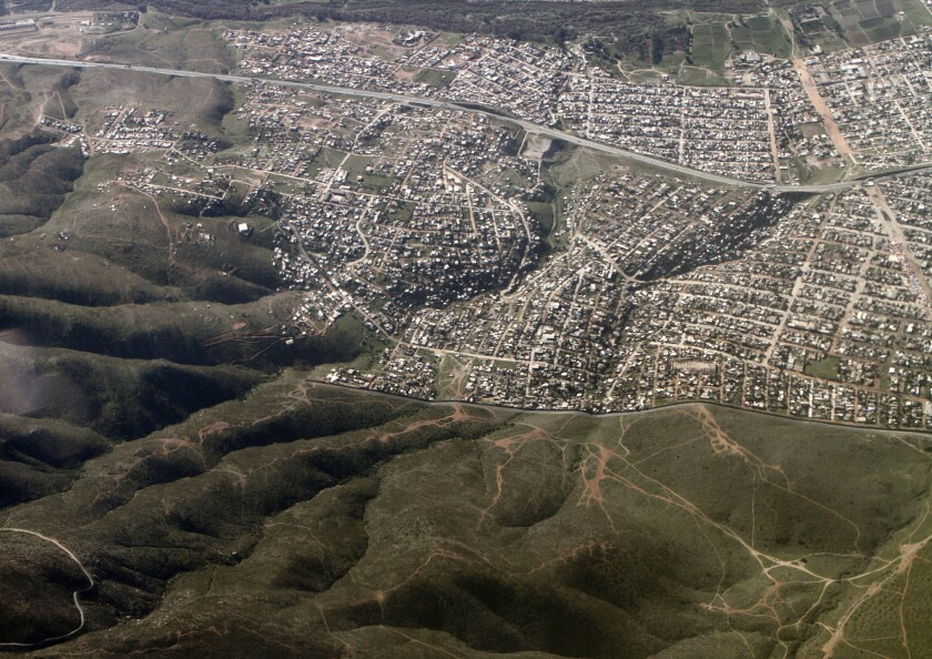 In San Diego County, trade seeps into every part of life; residents of both countries hop across the border for commutes, shopping and healthcare. Above, a view of the border on the eastern outskirts of Tijuana.