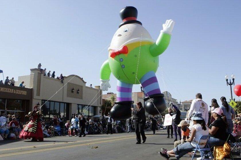 A giant Humpty Dumpty balloon floats along Main Street at El Cajon's Mother Goose Parade.