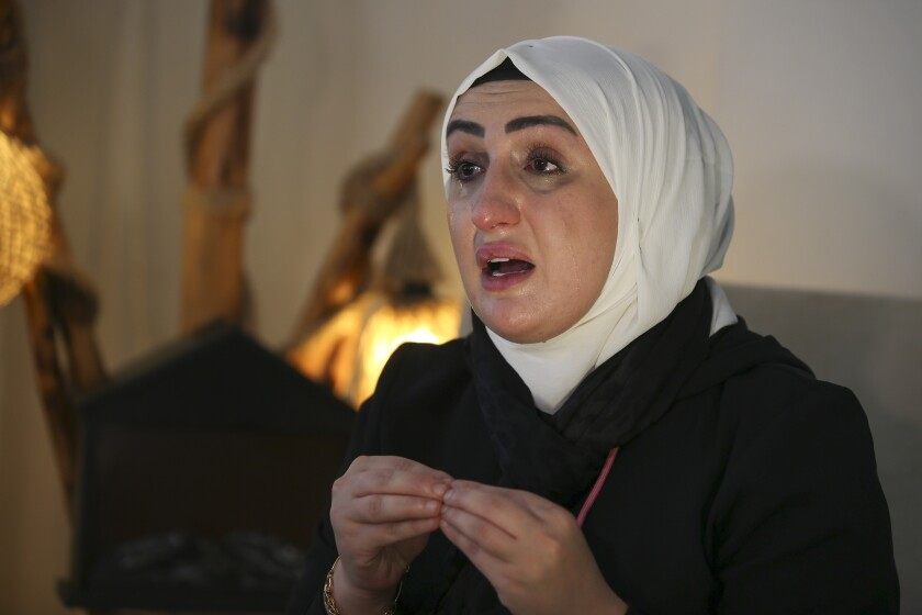 """Fatima Alzahra Shon, 32, a Syrian refugee talks to The Associated Press during an interview in Istanbul, Friday, Sept. 17, 2021. Fatima Alzahra Shon thinks neighbors attacked her and her son in their Istanbul apartment building because she is Syrian. The 32-year-old refugee from Aleppo was confronted on Sept. 1 by a Turkish woman who asked her what she was doing in """"our"""" country. Shon replied, """"Who are you to say that to me?"""" The situation quickly escalated.(AP Photo/Emrah Gurel)"""