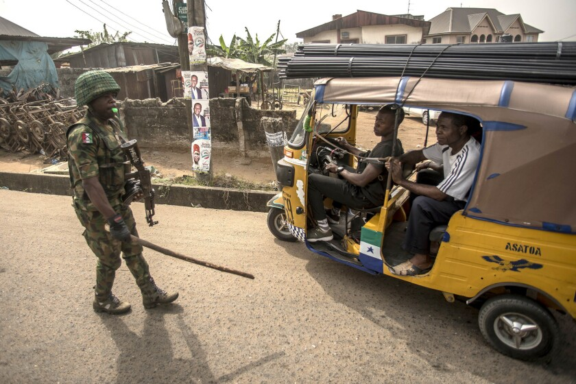 A Nigerian soldier controls the traffic in Aba, in a pro-Biafra separatist zone. The southeastern Nigerian region has long complained of being marginalized since the end of the civil war in 1970.