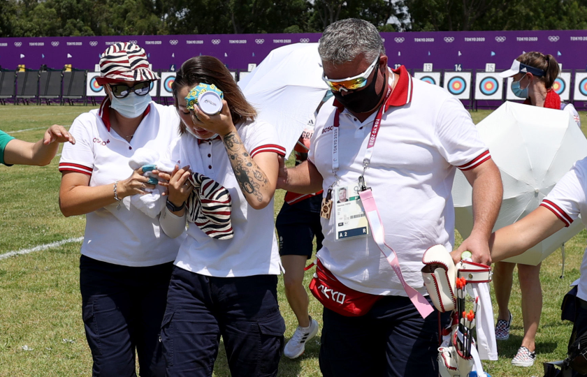 ROC archer Svetlana Gomboeva is treated for heat exhaustion at the Olympic Games on July 23.