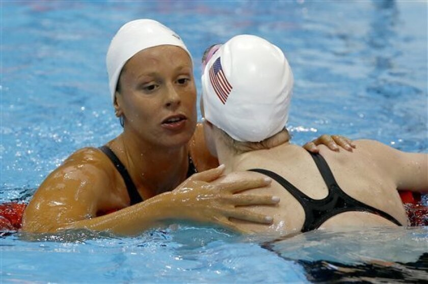 Italy's Federica Pellegrini, left, and United States' Missy Franklin react after competing in a women's 200-meter freestyle swimming heat at the Aquatics Centre in the Olympic Park during the 2012 Summer Olympics in London, Monday, July 30, 2012.(AP Photo/Daniel Ochoa De Olza)