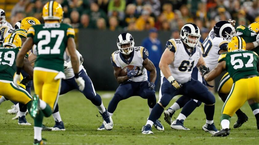 Los Angeles Rams' Justin Davis runs during the second half of a preseason NFL football game against