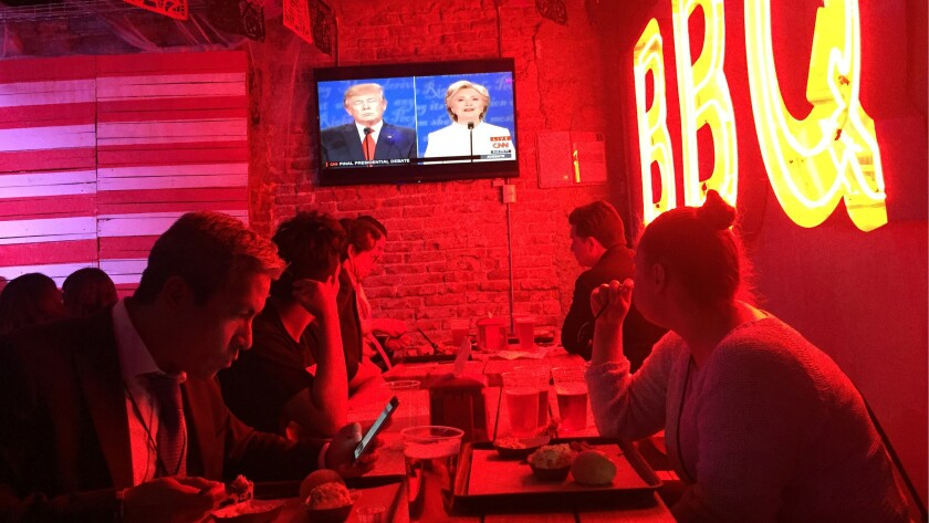 Patrons at a Mexico City restaurant watch the final presidential debate.