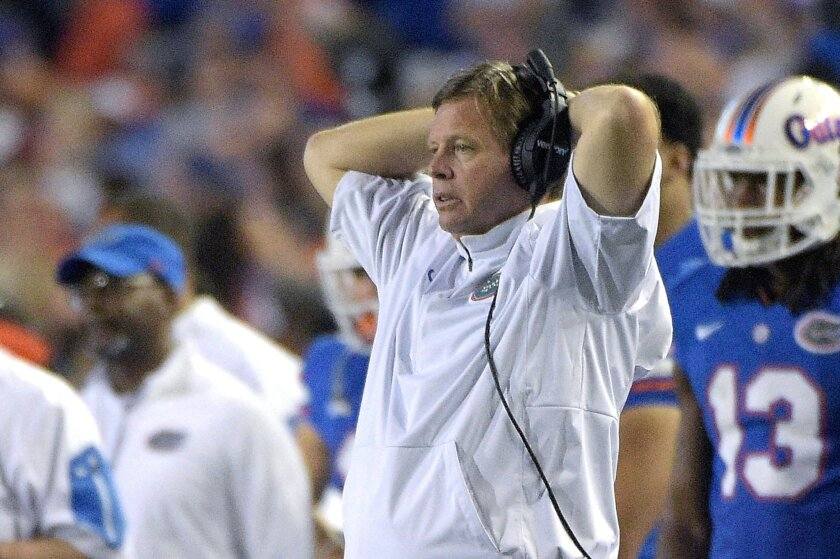 Florida head coach Jim McElwain reacts from the sideline during the second half of an NCAA college football game against Florida State in Gainesville, Fla., Saturday, Nov. 28, 2015. Florida State won 27-2. (AP Photo/Phelan M. Ebenhack)