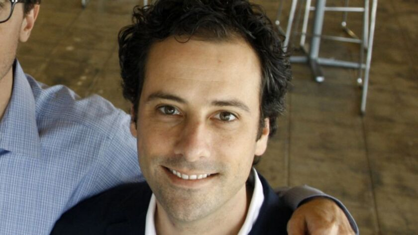 LOS ANGELES, CALIFORNIA - SEPTEMBER 19, 2013: Ben Smith (left), Editor-In-Chief, Jonah Peretti (midd