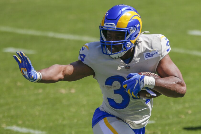 Rams running back Malcolm Brown gives a straight arm against the Eagles.