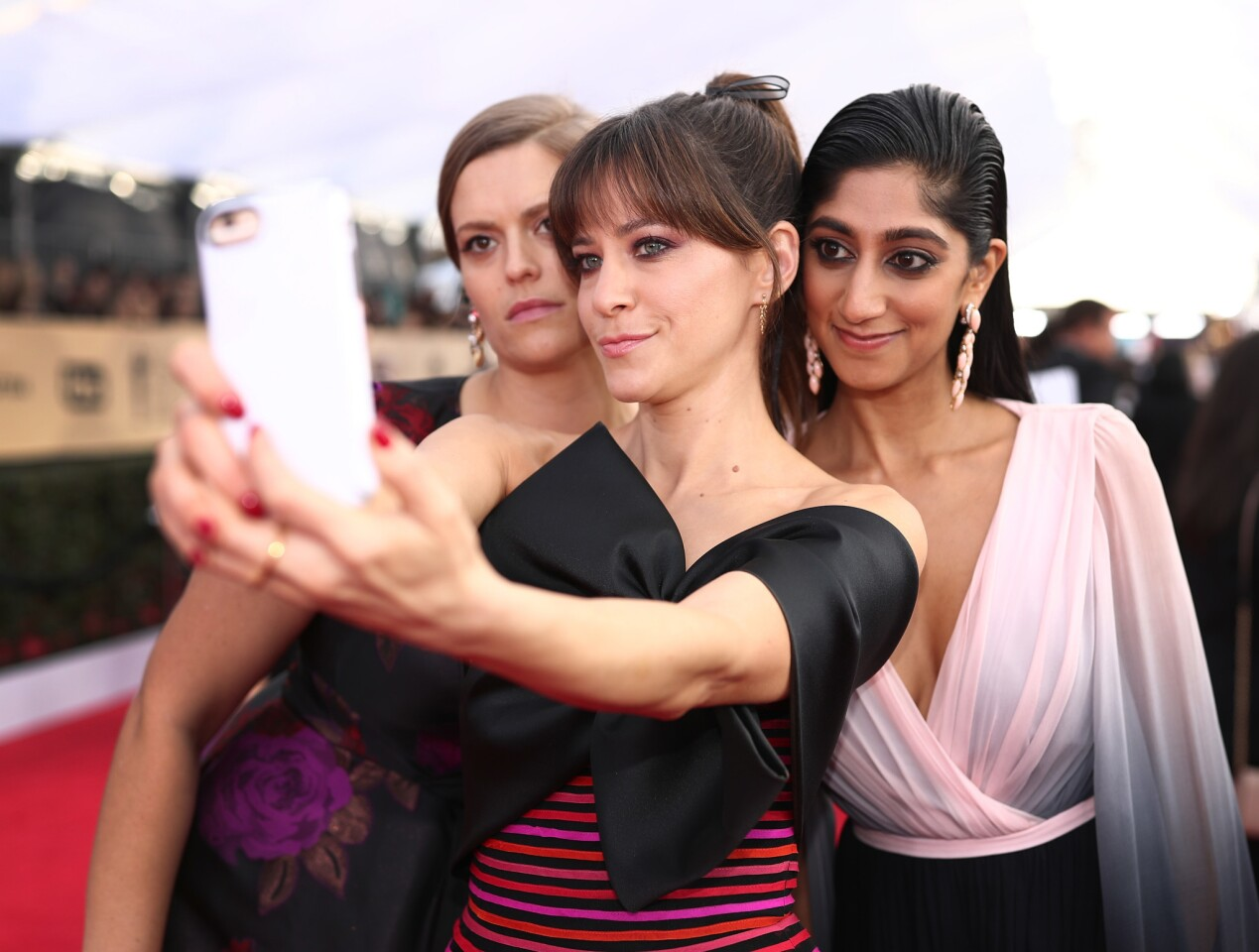 Marianna Palka, Jackie Tohn, AND Sunita Mani take a selfie at the 24th Annual Screen Actors Guild Awards at The Shrine Auditorium on January 21, 2018 in Los Angeles, California.