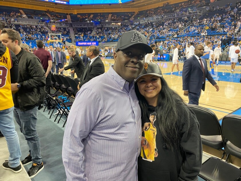 Remy Martin's parents, Sam and Mary Ann, pose while watching UCLA and Arizona State at Pauley Pavilion on Feb. 27.