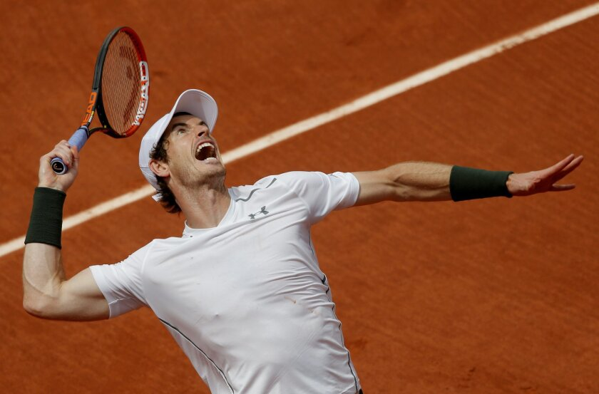 Britain's Andy Murray serves the ball to  Croatia's Ivo Karlovic during their third round match of the French Open tennis tournament at the Roland Garros stadium, Friday, May 27, 2016 in Paris. (AP Photo/Christophe Ena)