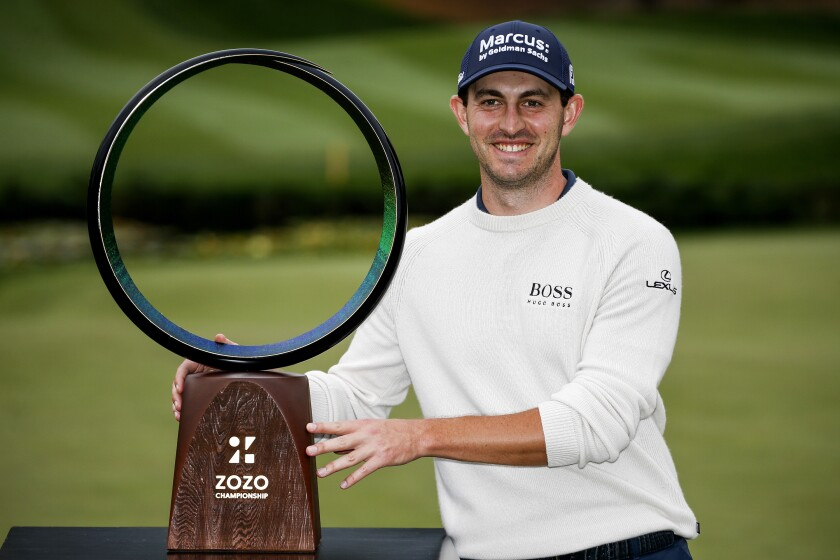 Patrick Cantlay poses with his trophy after winning the Zozo Championship golf tournament Sunday, Oct. 25, 2020, in Thousand Oaks, Calif. (AP Photo/Ringo H.W. Chiu)