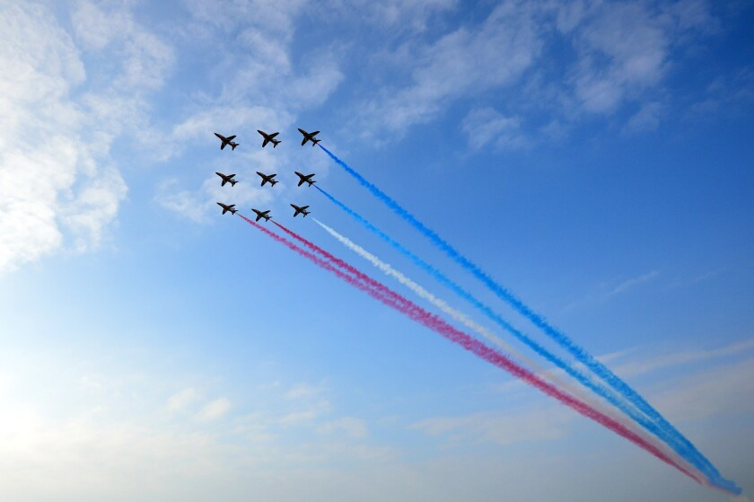 Britain's Red Arrows airplane display team perform over the NATO 2014 Summit at the Celtic Manor Hotel in Newport, South Wales.
