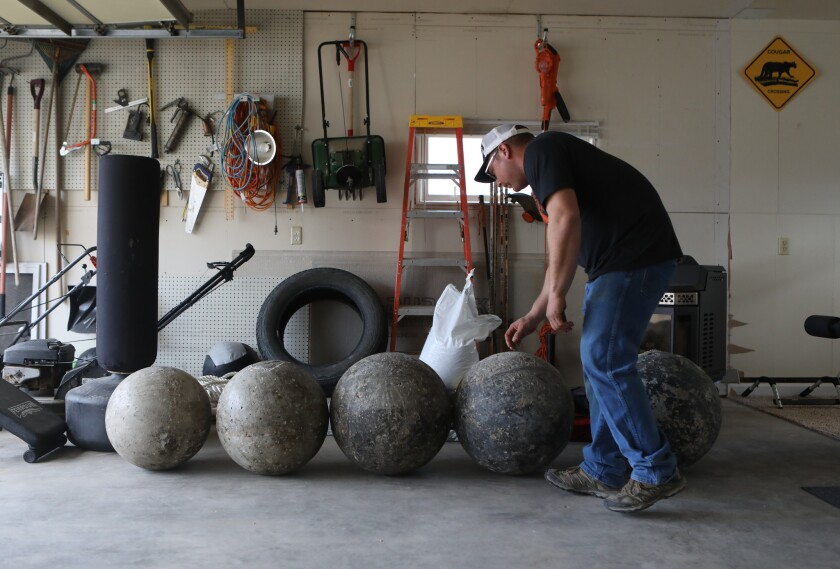 Cancer survivor Charley Butler, is training for a strongman competition at his home in Sidney, Montana