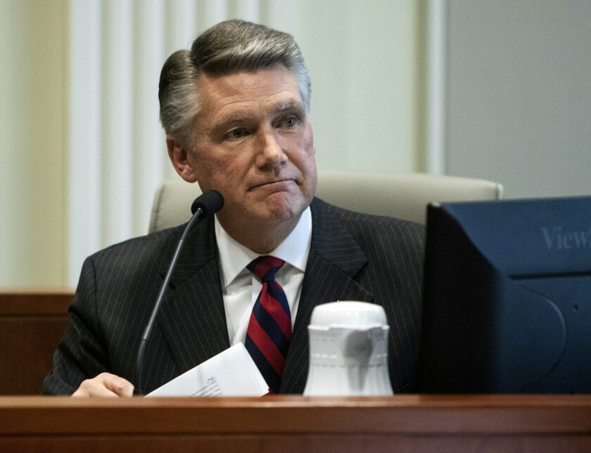 Mark Harris, Republican candidate in North Carolina's 9th congressional race, makes a statement before the state board of elections on Thursday, Feb. 21, 2019, at the North Carolina State Bar in Raleigh, N.C.