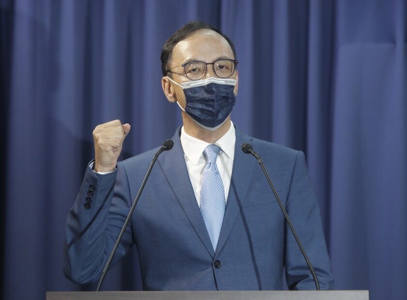 Eric Chu delivers a speech after winning in the Nationalist Party chairman election in Taipei, Taiwan, Saturday, Sept. 25, 2021. Taiwan's main opposition Nationalist Party, also known as the KMT, chose former leader Chu as its new chairperson Saturday in an election overshadowed by increasing pressure from neighbor China. (AP Photo/Chiang Ying-ying)