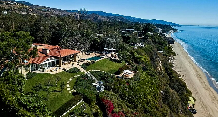 An aerial view of an oceanfront estate spanning three acres on Pacific Coast Highway in Malibu overlooking the beach
