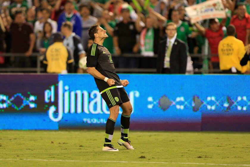 """Mexico's Javier """"Chicharito"""" Hernandez celebrates after scoring a goal against Chile in a friendly match at Qualcomm Stadium."""