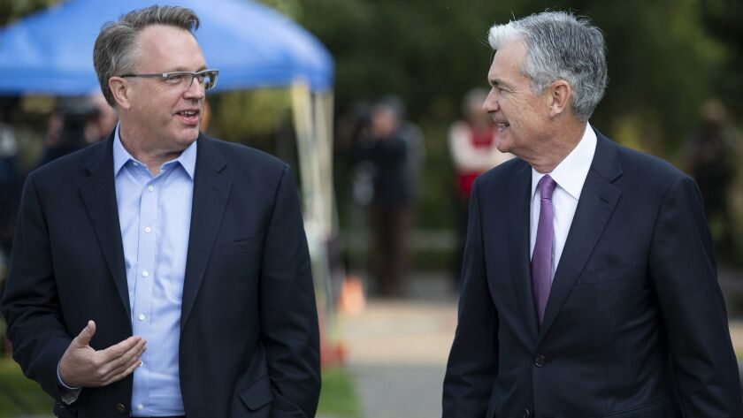 John Williams, left, president and chief executive of the Federal Reserve Bank of New York, speaks with Fed chief Jerome Powell in August.