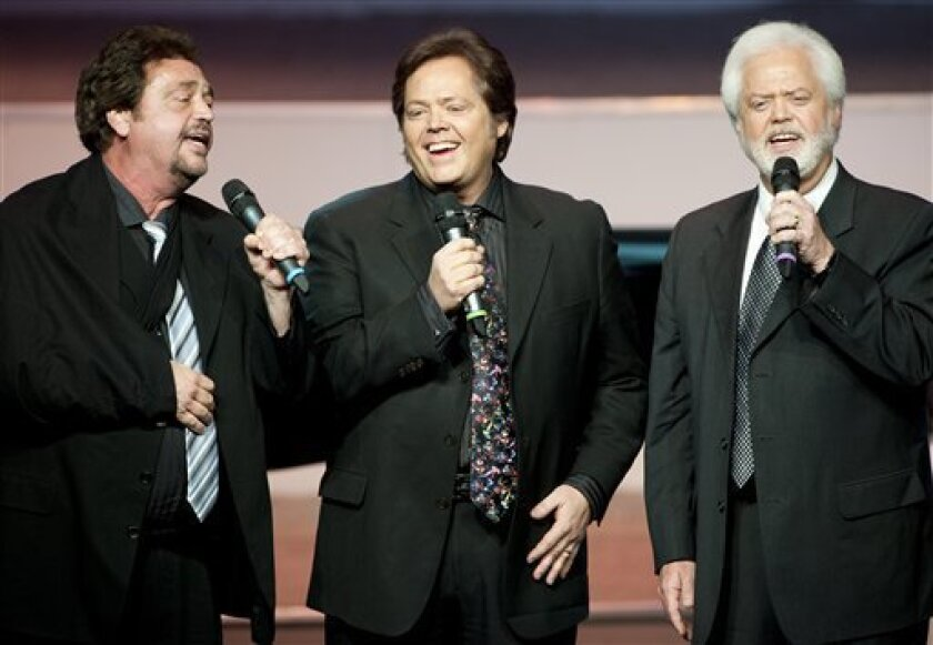 """From left, Jay Osmond,  Jimmy Osmond and Merrill Osmond sing at Andy Williams' memorial service at the Moon River Theater, in Branson, Mo., Sunday, Oct. 21, 2012. Williams, known for singing """"Moon River"""" and his Christmas television specials, passed away Sept. 25. (AP Photo/Grant Hindsley)"""