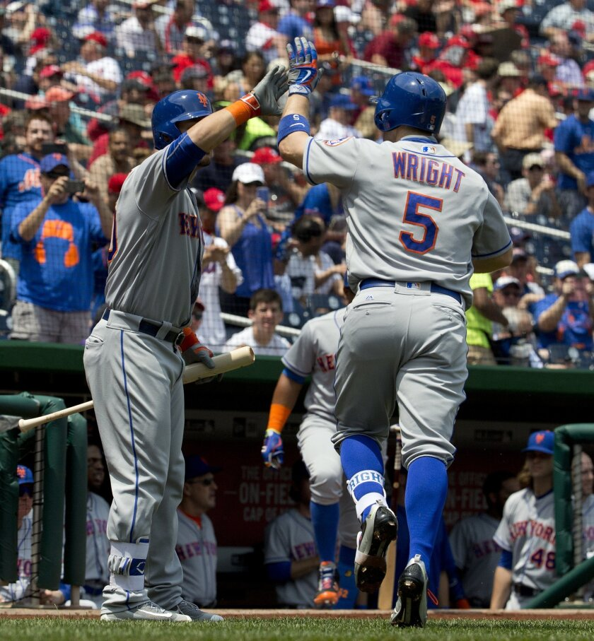 New York Mets' David Wright (5) is greeted by teammate Michael Conforto (30) after hitting a solo homer against the Washington Nationals in the first inning of a baseball game at Nationals Park, Wednesday, May 25, 2016, in Washington. Mets won 2-0. (AP Photo/Pablo Martinez Monsivais)