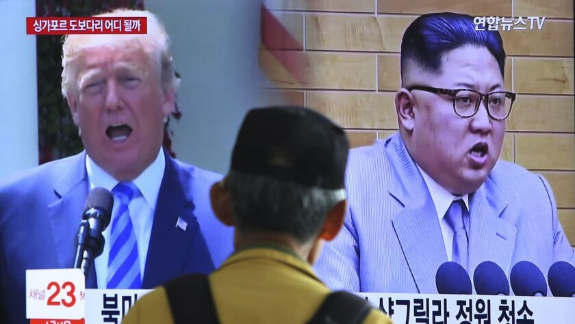 Images of President Trump and North Korean leader Kim Jong Un during a news program at the Seoul Railway Station.