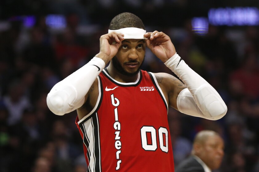 Trail Blazers forward Carmelo Anthony adjusts his headband during a game against the Clippers on Dec. 3 at Staples Center.