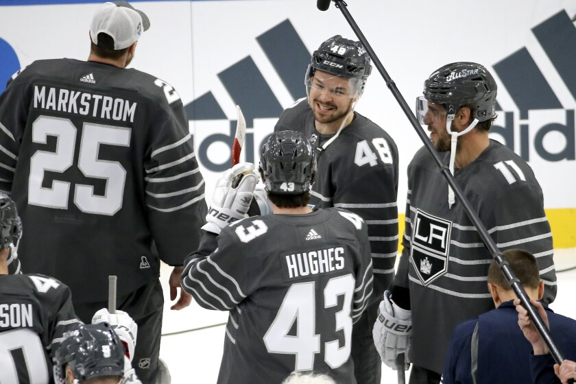 Sharks forward Tomas Hertl (48) talks with Canucks defenseman Quinn Hughes (43) and Kings forward Anze Kopitar (11) after the Pacific Division won the All-Star three-on-three tournament Jan. 25, 2020.