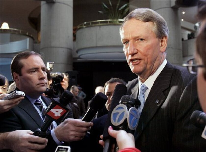 In this Dec. 19, 2008 file photo, General Motors Corp. CEO Rick Wagoner meets with the media after his news conference at the company's world headquarters in Detroit. Wagoner said Thursday, Jan. 8, 2009, the Detroit automaker can survive long-term without cutting benefits to retired workers.  (AP