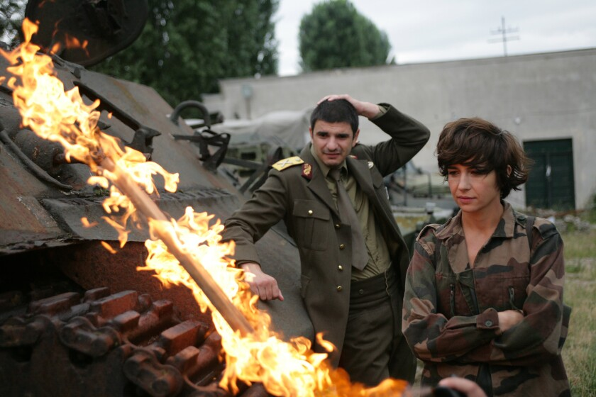 "Alex Bogdan, left, and Ioana Iacob in ""I Do Not Care If We Go Down in History as Barbarians."""