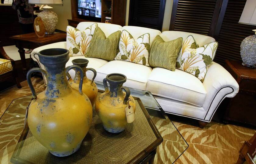 Yellow Tuscan pottery and a Bay Club sofa inside the new Tommy Bahama Home Store in Fashion Island.