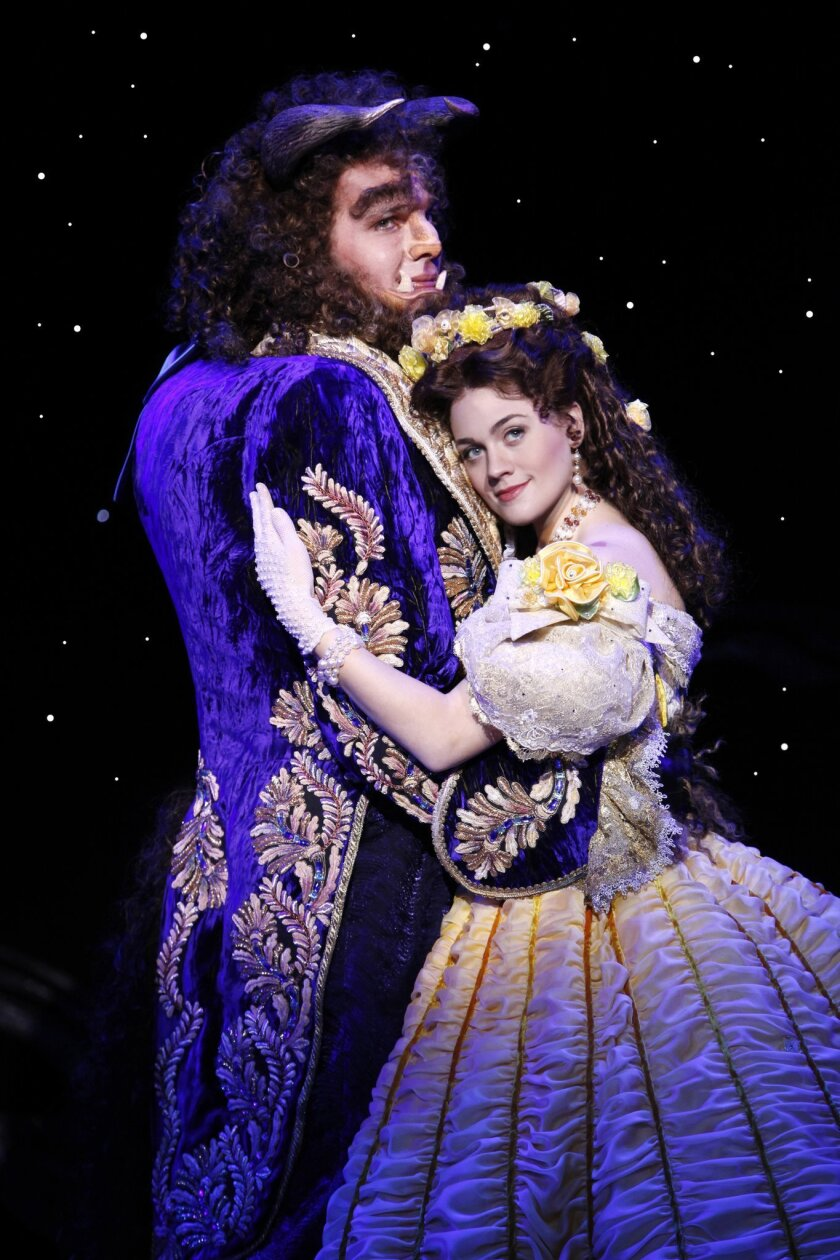 "Justin Glaser as Beast and Liz Shivener as Belle in Disney's ""Beauty and the Beast."""
