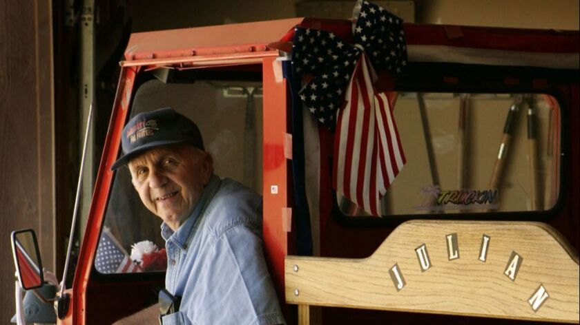 Jim Mazzone posed in his 1970 Cushman delivery vehicle at his home in Julian in this 2005 photo.