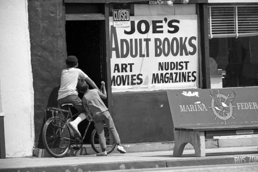 Two boys stop to investigate an adult book store in Lennox in August 1969.