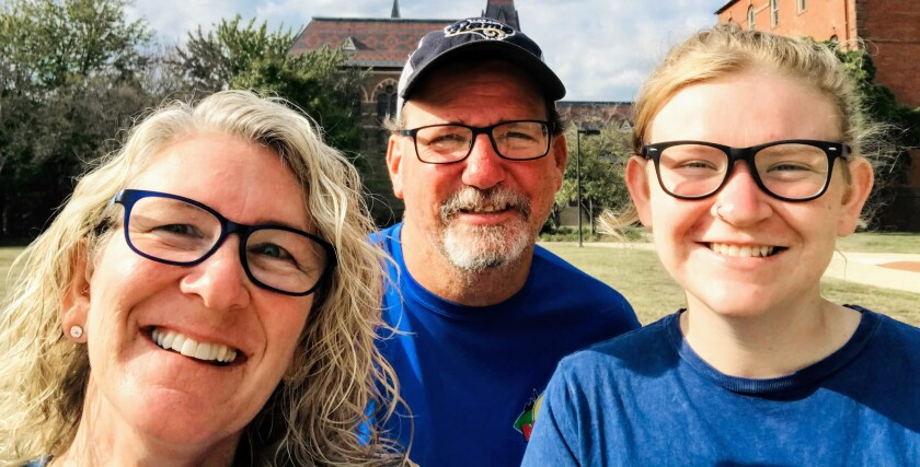 Lore Kinast, 51, with her husband, Patrick, 49, and daughter, Kameron, 21, all of whom are deaf. Lore plans to bring an iPad with her to try to communicate with nurses should she have to go to the hospital.