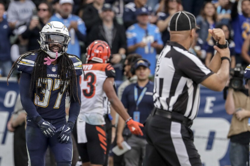 Chargers safety Jahleel Addae (37) glares at an official after he was called for holding against the Cincinnati Bengals on Dec. 9, 2018.