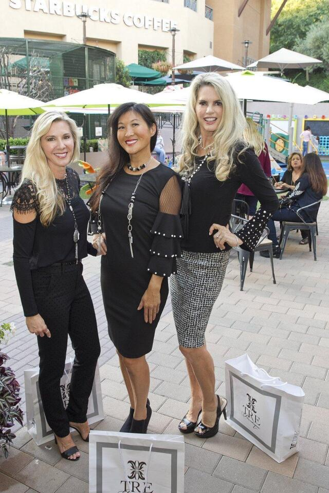 Tamara Palmer, Cami Rosso, and Laura Paulson model clothing from TRE Boutique