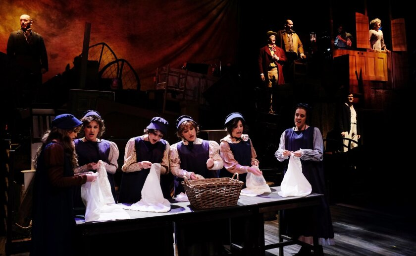 """A scene from Act 1 of """"Les Misérables"""" at Lamb's Players Theatre."""