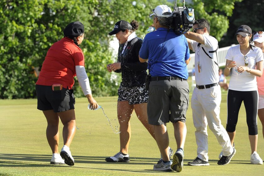 Ariya Jutanugarn, center, of Thailand, is doused in water by Christina Kim, left, and others after winning the LPGA Volvik Championship golf tournament at the Travis Pointe Country Club, Sunday, May 29, 2016 in Ann Arbor, Mich. (AP Photo/Jose Juarez)